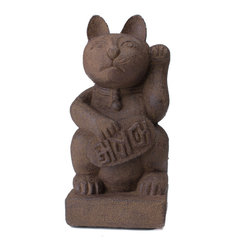 """Repose Home - Maneki Neko Lucky Cat - The Maneki-neko, also known as the """"Lucky Cat,"""" is a popular Japanese statue known to bring good luck to the owner. He is in his common beckoning pose and holding a coin that symbolizes his power in bringing good fortune and wealth."""