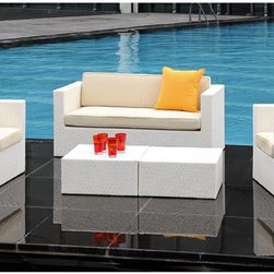 Tatta IV Wicker Lounge Chair - The Tatta IV outdoor lounge chair offers a compact size for small spaces and balconies. It has an aluminum frame wrapped with wicker in white or expresso colors.