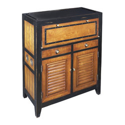 """Inviting Home - Cape Cod Locker Cabinet - Cape cod inspired wood locker cabinet; 13-3/4"""" x 29-1/2"""" x 37""""H; Wooden locker cabinet in light honey and antique black finish; Cabinet features a fold-out shelf to hold miscellaneous items and in general offer much appreciated workspace... At some point we realized our furniture collection was turning into a labor of love. Originally devised as a home for our Kunstkammer objects d'art we somehow turned a corner in celebrating the nostalgia of a past sailing era colonial trade and now... beach life and style. We strive to make the practical exude romance and the historical to include a touch of contemporary. With their air of beach-view porches and sun-filled mooring docks our beach lockers and cabinets celebrate Nantucket as well as Deauville. Making efficient use of every inch and centimeter lockers hold towels and sailors scarves polo gear and golfing shoes. Air circulates ingeniously banning odors and keeping things dry with fragrant freshness. Fold-out shelves hold shaving gear or jewelry prop up mirrors and in general offer much appreciated workspace. This locker is a veritable balancing act of the exotic and matter-of-fact...."""