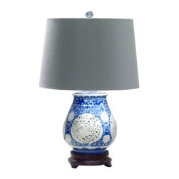 Blue Hollow Ceramic Holder Modern Table Lamps - The classic look of a blue and white patterned ginger jar never goes out of style. Chinese prints pair beautifully throughout the home and look especially sharp with a crisp white shade made of silk and lined in navy blue. It's an easy design to work into your living room, office or bedroom.