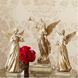 Band of Angels - Set of 3 - New - This trio is trumpeting the good news: Christ is born! With realistic features and flowing gowns, these winged angels are a beautiful faith-based addition to your Christmas décor. Arrange them on a buffet or on top of the mantel—or anywhere that needs a special blessing. They're lightweight, made from a resin cast, light enough for most shelving units.