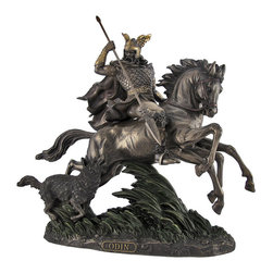 Bronzed Norse God Odin Riding Sleipner Statue - The Mighty Odin, wise and fierce Norse god, principal leader of the Aesirs, rides valiantly into battle on the legendary eight-legged steed, Sleipner. With intricately golden embroidered designs on Odin`s winged helmet and armor, the detail of this piece is unparalleled. One can almost feel the rushing wind as Odin`s fur cape flows behind him and the tall green-accented grass sweeps below. A vicious wolf companion accompanies Odin as he rushes on to meet the enemy with his unerring spear, Grungir, in hand. The figure is forged from cold cast resin and measures 12 1/2 inches long, 12 1/2 inches tall, and 6 inches wide. This magnificent piece would make a valiant mythological accent in any setting.