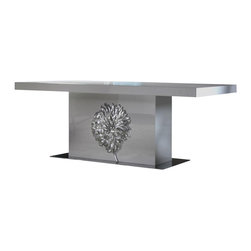 "VIG Furniture - Emma White Lacquer Dining Table With Silver Floral Emblem - The Emma dining table will be a great addition for adding a modern touch that will have you dining in luxury. This dining table is crafted from solid wood products making it a very durable table. The table comes with a standard size of 86.6"" perfect for larger gatherings. It has a white lacquer finish with a high gloss and a silver metal flower on the base that adds to the overall look. The price shown includes the table only"
