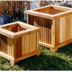 Wood Country Square Cedar Wood Nampa Patio Planter - Set of 2 - The Nampa Cedar Patio Planter - Set of 2 is an environmentally friendly and beautiful addition to any outdoor space. Vertical segments of cedar create an interesting natural color variation on these two convenient planters. Each sits atop four block feet and features pre-drilled drainage holes preventing seepage and staining on the bottom and helping your plants to breathe better. These two planters which can be used separately or together for maximum impact feature extra-wide sills to help lift up foliage. The cedar wood is finished in an all-weather stain. Choose from various sizes; you will receive two planters in the size you select.SIZE DIMENSIONS:Small Planter Box 21L x 21W x 13H inchesWeight: 19 lbs.Large Planter Box 21L x 21W x 17H inchesWeight: 26 lbs.About Cedar WoodCedar wood is lightweight and resistant to both cracking and moisture rot. The oils of this resilient wood guard against insect attack and decay and their distinctive aroma acts as a mild insect repellant. Cedar is a dependable choice for outdoor furniture either as a finished or unfinished wood. Over time unfinished cedar left outdoors will weather to a silvery gray patina. This natural process does not compromise the strength or integrity of the wood.About Wood CountryFine handcrafted outdoor furnishings are what Wood Country is all about. They manufacture a complete line of outdoor furniture and accessories made of clear kiln-dried Western Red Cedar. Each piece is hand-crafted and finished with a high quality penetrating oil weather stain. Wood Country is about offering their customers choices allowing them to create their own custom environment perfectly suited to enjoy their leisure time. Customers can choose the styles they like based on family need budget or just personal tastes. Wood Country uses the best materials hardware fabric and finishes they can find. Quality materials combined with Wood Country's talent means you're getting some of the best outdoor furniture available in today's market.