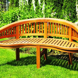 Monet 4ft. Garden Bench - The free flowing design of the Monet Bench is perfect for restful quiet moments or intimate conversations. This Monet Bench is constructed of Eucalyptus, a sustainable harvested wood. All eucalyptus furniture is stained for exterior use and may vary slightly depending upon the natural grain of the wood.