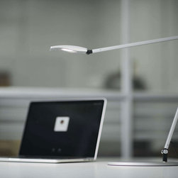Koncept Lighting - Mosso Pro LED Task Lamp with USB Port - The Mosso Pro LED Task Lamp with USB Port is available in Silver, Metallic Black or White finish.  Environmentally friendly using fully recyclable aluminum, water-based paint, FSC certified packaging, non-mercury containing LEDs and LEED credit eligibility. Built in occupancy sensor, and continuous dimming.  One 5.5 watt,1 20 volt LED module is included. Light varies from 2700K to 5000K.  21.2 inch width x 18.4 inch height.  Base is 9 inches in diameter.  Fully 360 degree lateral rotating head, 180 degree horizontal rotating head, 180 degree rotating arms and 90 degree rotating base.