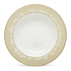Lenox Bellina Gold Pasta / Rim Soup Bowl - The Lenox Bellina Gold Pasta / Rim Soup Bowl will make an elegant and traditional addition to your dining room table. This bowl is crafted from fine white bone china and accented with a soft gold color and a subtle white floral pattern that ambles around the brim. With hand-enameled dots that line the outer edge, this bowl is accented with 24-karat gold and is dishwasher-safe. About Lenox Corporation Lenox Corporation is an industry leader in premium tabletops, giftware, and collectibles. The company markets its products under the Lenox, Dansk, and Gorham brands, propelled by a shared commitment to quality and design that makes the brands among the best known and respected in the industry. Collectively, the three brands share 340 years of tabletop and giftware expertise.