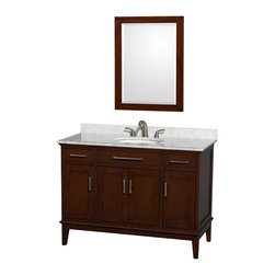 Wyndham Collection - 48 in. Eco-Friendly Transitional Single Bathroom Vanity - Include white Carrera marble countertop with backsplash and undermount oval sink. Faucet and mirror not included. Two functional drawers. Four functional doors. 8 in. widespread three hole faucet mount. 12 stage wood preparation, sanding, painting and hand-finishing process. Highly water-resistant low V.O.C. sealed finish. Practical floor-standing design. Deep doweled drawers. Fully-extending under-mount soft-close drawer slides. Concealed soft-close door hinges. Single faucet hole mount. Plenty of storage and counter space. Metal exterior hardware with brushed chrome finish. Engineered to prevent warping and last a lifetime. Made from zero emissions solid birch hardwood. Dark Chestnut finish. Vanity: 47 in. W x 21.5 in. D x 34.25 in. H. Vanity with Countertop: 48 in. W x 22 in. D x 35 in. H. Countertop: 48 in. W x 22 in. D x 0.75 in. H. Backsplash: 48 in. W x 0.75 in. D x 3 in. H. Warranty. Care Instructions. Counter Handling Instructions. Installation InstructionsBring a feeling of texture and depth to your bath with the gorgeous Hatton vanity series. A contemporary classic for the most discerning of customers. The Wyndham Collection is an entirely unique and innovative bath line. Sure to inspire imitators, the original Wyndham Collection sets new standards for design and construction.