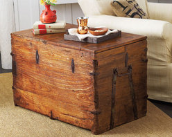 Vintage Wardrobe Trunk - A vintage trunk from the 1920s will act as both storage and a coffee table. It would look perfectly chic with white sofas and some industrial lighting. Be sure to ditch the tchotchkes for a more authentic French minimalist look.