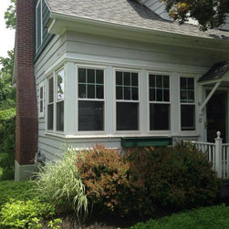Vinyl Windows - New double hung vinyl replacement windows with grids in the top sash only.
