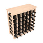 36 Bottle Kitchen Wine Rack in Pine - A small wine rack with big storage. This wine rack kit is the best choice for converting tiny spaces into big wine storage. The solid wood top excels as a table for wine accessories, small plants, and wine collectables. Store 3 cases of wine properly in a space smaller than most entry tables!