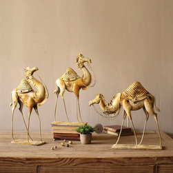 Three Fine Young Camels - These metal camels make a striking display together anywhere in your home. The antiqued white finish gives them a go-anywhere charm that suits their entrancing Middle Eastern flair.