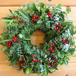 Holiday Eucalyptus Berry Wreath - Layered green eucalyptus and bay leaves make for a pretty and fragrant wreath. The bright red berries add a simple pop of color.