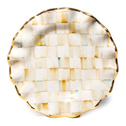 Parchment Check Fluted Dinner Plate   MacKenzie-Childs - With a warmly elegant attitude, a table set with Parchment Check Dinner Plates make guests feel both special and yet right at home. Each piece is handcrafted in Aurora of terra cotta, hand-painted in color-dragged checks, blending parchment, taupe, gold, and an irrepressible touch of aqua. Hand-applied gold lustre edges and accents. Kiln fired, four times. Hand-wash with care.