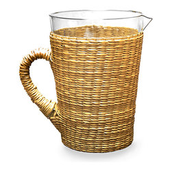 Sea Grass Pitcher - A wide handle contributes to the stable, relaxed feel of this transitional serving piece, the Sea Grass Pitcher. With natural golden-hued seagrass fibers woven securely around its tapering body, this ample vessel makes al fresco entertaining and afternoon drinks with friends an escapist event. Paired with other natural textures, the effect is most welcoming.