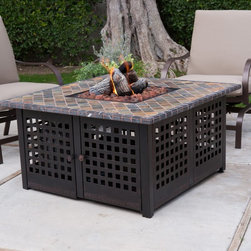 Uniflame - Gas Fire Pit: Uniflame LP Gas Fire Pit with Handcrafted Tile - Shop for Fire Pits and Fireplaces from Hayneedle.com! Gather your friends around for a cozy evening under the stars with the glow of a warm fire to light your faces and warm your bodies. This LP Gas Fire Pit is full of beautiful textures and materials and features stunning details. The metal base has a clean grid pattern and a rustic bronze finish. A hand-crafted slate mantel in warm soothing earth tones will make any patio inviting. The porcelain steel bowl will withstand the high temps and a protective cover is included. This fire pit is a snap to light thanks to the electronic ignition but it looks totally natural due to the hidden control panel. It includes a protective cover for the LP tank so it remains discreet. It includes lava rocks and ceramic logs too. Requires 20-lb. propane tank not included. Some assembly required. About Blue Rhino/Uniflame/Endless Summer:Blue Rhino Global Sourcing Inc. is America's #1 propane tank exchange brand but it doesn't stop there. Blue Rhino is a leading designer and marketer of outdoor appliances and fireplace furnishings. These products include barbecue grills outdoor heaters outdoor fireplaces mosquito traps and fireplace furnishings. You'll find a Blue Rhino product in the middle of half a billion barbecue events nationwide every year. They come under various brand names including UniFlame Endless Summer and SkeeterVac.