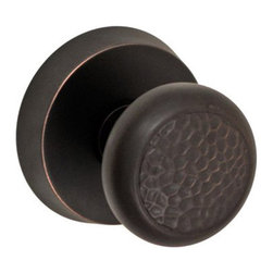 Fusion Hardware - Southwestern Hammered Half Round Knob - With beautiful texture to add a point of interest, the Fusion made Hammered Half Knob is the perfect accompaniment to any traditionally styled home. When paired with the Beveled Round Rose, this knobset really shines. Neither too overwhelming nor too plain, this door knob and rose set is just right and will be sure to add the perfect hint of classic appeal along with an uncanny attention to detail that only the most put together rooms seem to have.  Shown in oil rubbed bronze and priced as passage set.