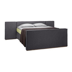 Andromeda I | COCO-MAT - Andromeda is a bed consisting of a headboard with side-wings, a small wooden base and an optional footboard. The base will not be visible but raise mattresses of