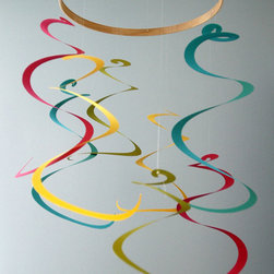 Spiral Art Mobile by Emalia's Fancy - This colorful, swirling mobile reminds me of streamers flung in the air. It would make the room feel like a celebration every day!