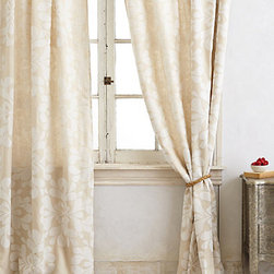 Anthropologie - Coqo Floral Curtain, Ivory - If you like to be more subtle with your floral prints, try this beautiful ivory curtain panel. It's subdued floral design would bring a feminine touch to any room.