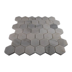 "Asian Statuary Hexagon Marble Mosaics - ASIAN STATUARY HEXAGON GLASS TILES These beautiful stone mosaics, each piece fits into the next like a perfect puzzle. Its stunning design and unique pattern of hexagon shaped asian statuary tiles in a polished finish. The stones will bring warmth and a natural feeling to your bathroom, kitchen, and any other decorated spot in your home. Chip Size: Hexagon 2"" Color: Asian Statuary Material: Asian Statuary Finish: Polished Sold by the Sheet - each sheet measures 12"" x 12"" (1 sq. ft.)"