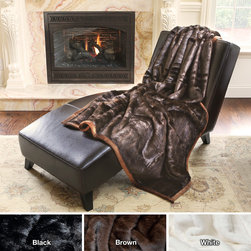 None - Mink Faux Fur Oversize Throw - Cover up on a cold night with this warm plush throw made of microfiber and faux fur. It also looks beautiful when used as a decor piece,thrown over a couch or chair. The plush backing is 100 percent polyester and the faux fur is 100 percent acrylic.