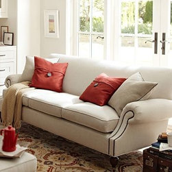 "Brooklyn Upholstered Sofa, Polyester Wrap Cushions, Washed Linen-Cotton Lagoon - Our Brooklyn sofa is distinguished by its smart, tailored look. Crafted in America with impeccable style and sink-in comfort, it has pleated roll arms that are outlined with antique-bronze nailheads and a scooped design that maximizes legroom. 87"" w x 36"" d x 34"" h {{link path='pages/popups/PB-FG-Brooklyn-3.html' class='popup' width='720' height='800'}}View the dimension diagram for more information{{/link}}. {{link path='pages/popups/PB-FG-Brooklyn-4.html' class='popup' width='720' height='800'}}The fit & measuring guide should be read prior to placing your order{{/link}}. Polyester-wrapped cushions have a tailored and neat look. Proudly made in America, {{link path='/stylehouse/videos/videos/pbq_v36_rel.html?cm_sp=Video_PIP-_-PBQUALITY-_-SUTTER_STREET' class='popup' width='950' height='300'}}view video{{/link}}. For shipping and return information, click on the shipping info tab. When making your selection, see the Special Order fabrics below. {{link path='pages/popups/PB-FG-Brooklyn-5.html' class='popup' width='720' height='800'}} Additional fabrics not shown below can be seen here{{/link}}. Please call 1.888.779.5176 to place your order for these additional fabrics."