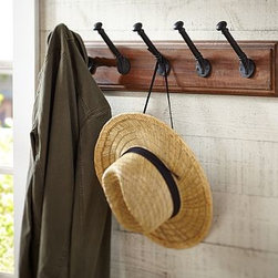 "Niko Wood & Metal Row of Hooks - Give coats, hats and leashes a place to go with our handy row of hooks. 31.5"" wide x 5.5"" deep x 7"" high Backing made of mango wood. Hooks made of aluminum with a bronze finish. Mounting hardware included. Catalog / Internet only."