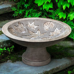 Campania International - Campania International Falling Leaves Cast Stone Birdbath - B-162-AL - Shop for Outdoor from Hayneedle.com! Taking cues from nature the Campania International Falling Leaves Cast Stone Birdbath has a calming organic style for your home's garden. This birdbath is made to endure from cast stone and will age beautifully in the elements. You can let your personal style out with a choice of available finish.Dimensions:Length: 19 in.Width: 19 in.Height: 10 in.Campania Cast Stone: The ProcessThe creation of Campania's cast stone pieces begins and ends by hand. From the creation of an original design making of a mold pouring the cast stone application of the patina to the final packing of an order the process is both technical and artistic. As many as 30 pairs of hands are involved in the creation of each Campania piece in a labor intensive 15 step process.The process begins either with the creation of an original copyrighted design by Campania's artisans or an antique original. Antique originals will often require some restoration work which is also done in-house by expert craftsmen. Campania's mold making department will then begin a multi-step process to create a production mold which will properly replicate the detail and texture of the original piece. Depending on its size and complexity a mold can take as long as three months to complete. Campania creates in excess of 700 molds per year.After a mold is completed it is moved to the production area where a team individually hand pours the liquid cast stone mixture into the mold and employs special techniques to remove air bubbles. Campania carefully monitors the PSI of every piece. PSI (pounds per square inch) measures the strength of every piece to ensure durability. The PSI of Campania pieces is currently engineered at approximately 7500 for optimum strength. Each piece is air-dried and then de-molded by hand. After an internal quality check pieces are sent to a finishing department where seams are ground and any air holes caused by the pouring process are filled and smoothed. Pieces are then placed on a pallet for stocking in the warehouse.All Campania pieces are produced and stocked in natural cast stone. When a customer's order is placed pieces are pulled and unless a piece is requested in natural cast stone it is finished in a unique patinas. All patinas are applied by hand in a multi-step process; some patinas require three separate color applications. A finisher's skill in applying the patina and wiping away any excess to highlight detail requires not only technical skill but also true artistic sensibility. Every Campania piece becomes a unique and original work of garden art as a result.After the patina is dry the piece is then quality inspected. All pieces of a customer's order are batched and checked for completeness. A two-person packing team will then pack the order by hand into gaylord boxes on pallets. The packing material used is excelsior a natural wood product that has no chemical additives and may be recycled as display material repacking customer orders mulch or even bedding for animals. This exhaustive process ensures that Campania will remain a popular and beloved choice when it comes to garden decor.About Campania InternationalEstablished in 1984 Campania International's reputation has been built on quality original products and service. Originally selling terra cotta planters Campania soon began to research and develop the design and manufacture of cast stone garden planters and ornaments. Campania is also an importer and wholesaler of garden products including polyethylene terra cotta glazed pottery cast iron and fiberglass planters as well as classic garden structures fountains and cast resin statuary.