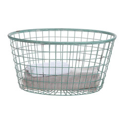 Oval Wire Basket - This wire basket is just the thing for artfully displaying extra blankets. We're fans of its soft oval shape and its light blue shade—it somehow gives this otherwise industrial container a special charm.