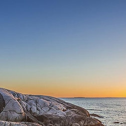 Magic Murals - Lighthouse Sunset Panorama Wall Mural -- Self-Adhesive Wallpaper by MagicMurals - This panoramic vista captures the sun setting over the waters of the Atlantic as the lighthouse at Peggy's Cove in Nova Scotia, Canada looks on while protecting the rocky coast and shoreline.