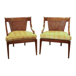 "Mid-Century Caned Back Arm Chairs - A Pair - A pair of Mid-Century caned back arm chairs. These chairs feature a very low profile, simple seating for just about any decor. These Mid-Century chairs are curvy and in excellent, original vintage condition. The caned backs is in good condition. The original vibrant golden yellow striped fabric is in excellent shape. The fabric seats have zippers for easy cleaning or re-upholstery. There is minor surface wear to wood frame. The wood type is unknown. Seat height 17.5""."