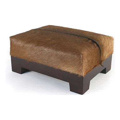 Goat Hide Footstool - Handsome footstool in goat hide with a dark brown Margosa wood base. We love the graphic natural variation found in each individual goat hide. It contrast beautifully with a leather chair and each piece is completely unique.