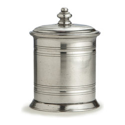 Roma Small Pewter Canister - Sized to hold cotton swaps on the counter of an elegant, stylish European-inspired bathroom, this Italian pewter vanity jar offers a lidded canister for myriad small necessities of the vanity table. Restrained, symmetrical styling coordinates with any chic decor style, but makes a particularly apt addition to the collections of those who appreciate the quiet beauty of traditionally-made pewter. Shallow rings streamline the vessel's shape.