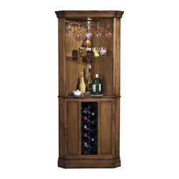 Howard Miller - Howard Miller Piedmont 13 - Bottle Wine Storage Bar - 690000 - Shop for Bars and Bar Sets from Hayneedle.com! What We Like About the Piedmont Wine Bar:This wine bar takes advantage of the often unused corner that every home has. The corner design of the wine bar offers a broad opening to store and reach your spirits or wine. The fairly simple design of the wine bar assures it will fit into most decoration styles. The unique design of the lower door has three panels two of wood and one of glass. The center glass panel covers the tall slim wine rack and is flanked by the two solid panels which hide two small storage areas each with a fixed shelf. Because it is designed for the corner the Piedmont Wine Bar is equipped with floor levelers to accommodate carpet wood or vinyl flooring.The Howard Miller StoryIncomparable workmanship unsurpassed quality and a quest for perfection - these were the cornerstones of the company Howard C. Miller founded back in 1926 at the age of 21. Even then Howard Miller understood the need to create products that would be steeped in quality and value.In 1989 Howard Miller began creating collectors' cabinets with the same attention to detail and craftsmanship inherent in their clock-making. Fashioned from glass and hardwoods Howard Miller cabinets are ideal for displaying heirlooms plates glassware and other collectibles.A highly respected brand Howard Miller maintains its popularity because of the company's commitment to quality. Every product manufactured at the company's sprawling facility in Zeeland Michigan undergoes stringent tests and exceeds industry standards to ensure a lifetime of enjoyment.