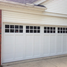Traditional Garage And Shed by Premier Door Service of Detroit