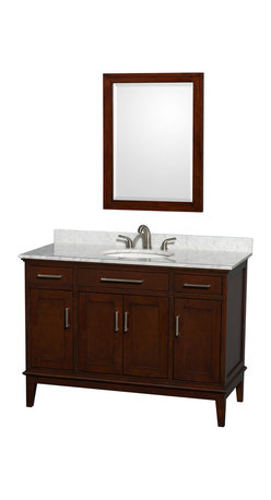 Wyndham Collection - Eco-Friendly Single Bathroom Vanity with Mirror - Includes white Carrera marble countertop with backsplash and oval undermount porcelain sink. Faucet not included. Transitional style. 8 in. widespread three hole faucet mount. Practical floor standing design. Four functional doors. Two functional deep doweled drawers. Fully extending under-mount soft-close drawer slides. Concealed soft-close door hinges. Metal exterior hardware in brushed chrome. 12-stage wood preparation, sanding, painting and hand finishing process. Highly water-resistant low V.O.C. sealed finish. Plenty of storage space. Engineered to prevent warping and last lifetime. 1.25 in. mirror thickness. Made from zero emissions solid birch hardwood. Dark chestnut finish.