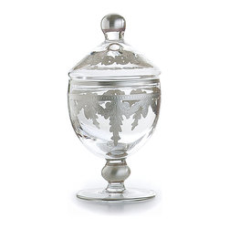 Baroque Silver Small Canister - Sumptuous metallic draperies surround the Silver Baroque Canister, which has an eye-catching arrangement of elegant motifs etched and hand-painted into its curving glass walls, but expresses this luxurious design in a subtle silvery palette of perfectly clear glass and shimmering white metal.  A matching blown glass lid covers the bell-shaped vessel, which sits lofty and graceful on a silver-painted stem to look both delicate and distinctive in your home.
