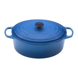 Le Creuset - Enameled Cast Iron 6 3/4-Qt. Oval Dutch Oven - For generations, families have come to cherish this everyday French Oven (or Dutch oven, referred by most people). Ideal for simmering, marinating, poaching, braising, and browning; this piece moves from the stove or oven to the table and can store leftovers in the refrigerator or freezer! Features: -Oval Dutch oven.-Material: Enameled Cast Iron.-Lid traps heat and seals in flavor and moisture.-Phenolic knob is oven safe to 480°F.-45% Larger handles.-Interior sand enamel.-Newly stable and tight-fitting designed lid.-Roomy enough for lifting with an oven mitt.-Longer retains heat.-Evenly spreads heat.-Easy to grip.-Ideal to use when making soups, rice dishes, casseroles, roasts, quiches, one pot meals, baked recipes, desserts, cakes and breads.-Works well on all heat sources, including induction and oven safe.-Refrigerator and freezer safe.-Dishwasher safe, recommended Hand washing.-Capacity: 6 3/4-Qt..-Provides even heat distribution and superior heat retention; colorful exterior enamel resists chipping and cracking.-Advanced sand-colored interior is durable, makes it easy to monitor food as it cooks to prevent burning or sticking.-Collection: Enameled Cast Iron.-Distressed: No.-Country of Manufacture: France.Dimensions: -Dimensions: 4.5'' H x 12.2'' W x 9.5'' D.-Overall Product Weight: 13.9 lbs.Warranty: -Lifetime limited warranty.