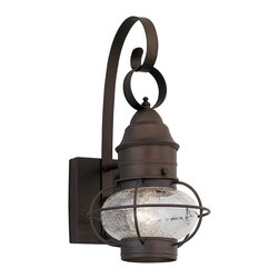 Designers Fountain - Designers Fountain Nantucket Outdoor Wall Sconce X-TR-1571 - This Designers Fountain Nantucket Outdoor Wall Sconce is sure to gain praise and admiration from anyone who sees it hanging in your home. It features a rounded, clear seeded glass shade encased by a cage frame in a rustique finish and with a nautical look and feel. It's a wonderful addition to most any outdoor space, and is sure to light up your home in style.