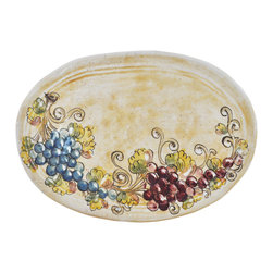 Abbiamo Tutto - Rustic Grape Oval Platter - Hand formed on a potters wheel and hand painted, the Rustic Grape Collection Serving oval platter gives just the right Tuscan touch to your table and home. Design includes various shades of red and blue with an amber honey glaze. Made entirely in Italy for Abbiamo tutto. It is food safe and lead free. The ceramic pieces are uneven in shape and variations in color and design are part of the magic and beauty of each piece. Collect all of the items in this collection to bring a special part of Tuscany to your home.