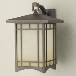 Murray Feiss August Moon Outdoor Wall Lantern - 16.5H in. Corinthian Bronze - The Murray Feiss August Moon Outdoor Wall Lantern can be used around garage doors or a side entry. This light features a Corinthian bronze finish and antique excavation glass shades. For ample outdoor lighting use one 150-watt E bulb. Clean the fixture with a damp cloth and mild soapy water and the shades with household glass cleaner. This light measures 16.5H x 10.5W x 13D inches with a 4.5 x 14.5-inch mounting plate.About Murray Feiss LightingThree generations have built Murray Feiss as a renowned name in lighting and it now stands as a leader with a reputation for impeccable craftsmanship innovative design and honest value. Murray Feiss prides itself as the foremost designer and manufacturer of interior and exterior lighting and home decor in the lighting industry. Over 3 800 skilled artists and technicians bring Murray Feiss designs to life meticulously finishing and quality-testing each exclusive product. Murray Feiss Lighting has expanded its extensive copyrighted line of products to include grand chandeliers casual fixtures vanity bath lights with coordinated bath hardware outdoor lighting lamps torchieres wall brackets mirrors and decorative accessories. Whether outdoor or in lighting from Murray Feiss means high quality and innovation.