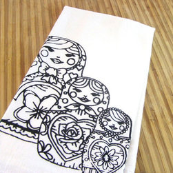 Matryoshka Dolls Tea Towel - Wipe up spills and messes in style with this Matryoshka Dolls Tea Towel. The screen-printed flour sack towel is made of 100% organic cotton, substantially more absorbent than a paper towel. Patterned with non-toxic ink, it's machine washable and is built to last to last through holiday after holiday season.