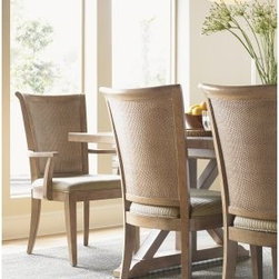 Lexington Home Brands Los Altos Arm Chair - Set of 2 - The subtle sophistication and graceful curves of the Los Altos Arm Chair - Set of 2 sets off the sophistication of the double woven split rattan backs. Extremely comfortable, you'll love sitting long after dinner and talking with friends and family alike while enjoying drinks and good company. Its Grey Elm veneer construction features an oyster white glaze which accents its sandy brown finish. These chairs are gently wire-brushed to highlight their grain lines and bring out the natural beauty of the wood. Sandy brown cloth seats with a woven design not only accents the wood, but makes for comfortable seating. Gracefully curved arms softens the linear design and adds a gentle softening to your decor. Blending natural and light wood tones, these chairs are inspired by the understated style of the West Coast and its beautiful, transitional design. These chairs are also great for when you need to get some work done, pay bills, or any other task which requires sitting for long periods. Additional Features Extremely comfortable design Gracefully curved arms softens the linear design Gorgeous wood construction Blends natural materials and light wood tones Inspired by the understated style of the West Coast Clean lines and elegant simplicity Set of 2 side chairsAbout Lexington Home BrandsFounded in 1903 in High Point, NC, Lexington Home Brands has become a globally known manufacturer and marketer of unique home furnishings. They are an industry leader in design, style, and quality products. Their product line consists of upholstered and hardwood furniture under recognized brands such as Lexington, Tommy Bahama, Sligh, and Henry Link Trading Co.. Lexington Home Brand's intentions and aspirations are to create exclusive designs and styles that accommodate the traditional, contemporary, casual, and formal decors of their customers' homes.