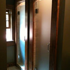 Frameless Shower Doors - His and hers single frameless shower door, using oil rubbed bronze hardware and acid etched glass.