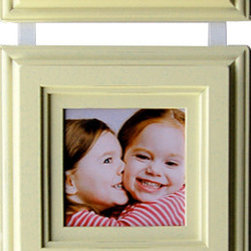 MyBarnwoodFrames - Ivory Picture Frame SetThree 5x5 Ivory Frames on Ribbon - Picture frame set, ivory painted wood with three 5x5 photo frames on a hanging ribbon.  This set is a favorite for weddings and baby showers. Put the bride and groom's invitation inside for a thoughtful gift, or add three of your favorite photos and hang one on the nursery wall. This multi-frame set also looks great if you purchase two and hang them on either side of a wall clock or other wall decor piece. Just loop the ribbon over any decorative hook, a unique drawer pull fastened directly into the wall, or hang it from a picture frame rod.   This classic ivory frame includes three frames for the price of one! Handcrafted from hardwood with an ivory hanging ribbon, this multi-frame set accommodates three 5x5 photos. You can also add prints, artwork and even remove the glass and add three-dimensional items. Hang a series of three of your favorite photos. Hand distressed edges, superb craftsmanship.