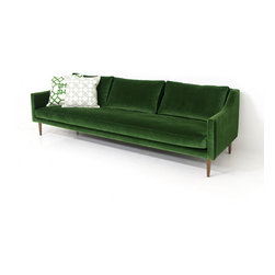 Naples Sofa, Emerald-Green Velvet - Modern Italian styling meets our eclectic sensibility with the new Naples sofa.  The thin frame and luxurious cushions means this sofa carries a light and airy feel, like a Mediterranean breeze, and offers a great level of comfort.  Finished here in Emerald Velvet fabric and our custom walnut cone legs.