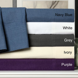 None - Solid Flannel Cotton Sheet Set or Pillowcase Separates - This flannel sheet set features choice of white,navy,purple,grey or ivory color options. Made of 100-percent cotton,this flannel will bring the comforts of a warm log cabin to your bedroom every night.
