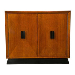 Pre-owned Mid-Century Modern Stained Birch Cabinet - Excellent proportions distinguish this Amber stained Birch cabinet with lacquered accents and interior. Equally suitable as either a bar, foyer, or many other applications. The black base is diagonally cut to mimic the door fronts, which are contrast-stained and have a diagonal cut design. The black door pulls match the black base and black interior cabinet shelves.