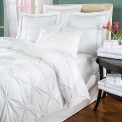 Metropolitan Duvet Cover & Shams - Supremely stylish duvet cover and shams uniquely feature contemporary floral smocking and softly textured three-dimensional gathers for volume and tons of dimension making it the focal point of any bedroom. Luxurious 100% long-staple Egyptian cotton in classic white. Available in duvet cover with button closure and shams with envelope closure. Create a wonderful mix of textures in soothing shades of white when coordinated with any of our beautiful bed ensembles and matelasse bedding items.  Made in Portugal.